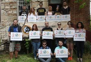 SFL-ers pose with signs featuring the 2nd June Movement logo.